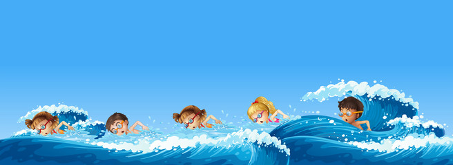 Many children swimming in the ocean