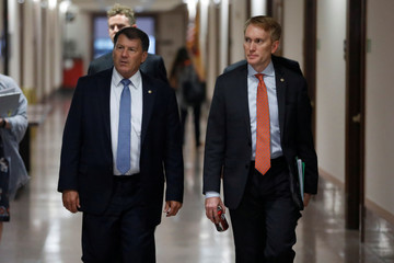Senator Mike Rounds (R-SD) and at right Senator James Lankford (R-OK) arrive for a meeting about the Republican healthcare bill on Capitol Hill in Washington