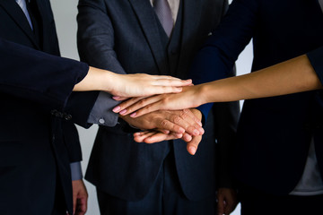 Business people joining hands together, success and team work concept.