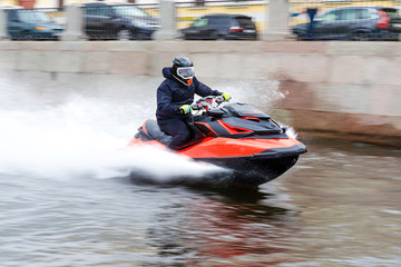 Recess Fitting Water Motor sports Young guy cruising on the a river chanel on a jet ski