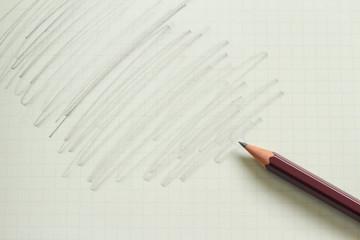 鉛筆で黒く塗りつぶしたノート