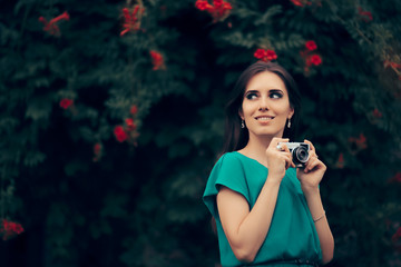 Happy Woman with Vintage Camera at a Garden Party Event