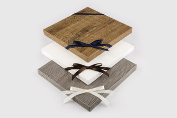 Three kitchen door samples decorated with beautiful bows on white kitchen surface
