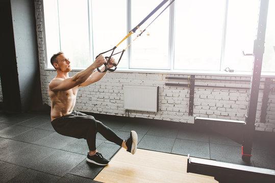 Man in sportswear exercising at gym