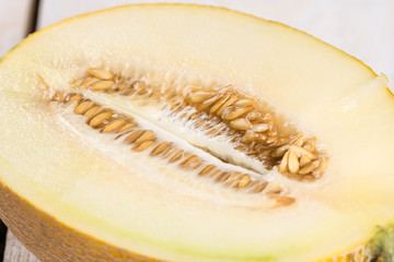 Sliced fresh melon on the wooden board table