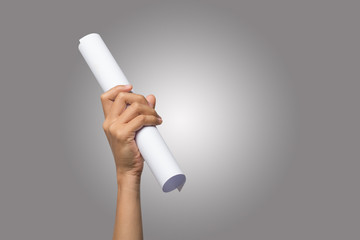 Close Up of hand holding paper roll isolated on white background.