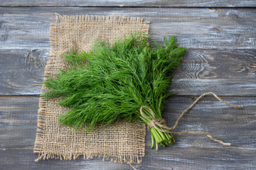 Door stickers Condiments Bunch of fresh dill on a wooden surface with free space. Rustic style, selective focus