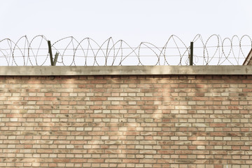 Brick walls and barbed wire