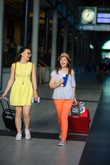 Young women with tickets and Luggage.