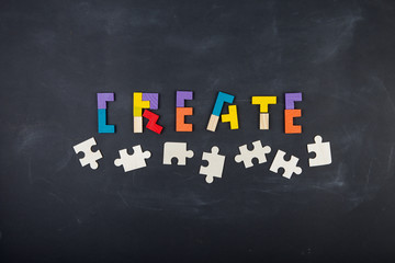 Business creative solution concept jigsaw on the blackboard