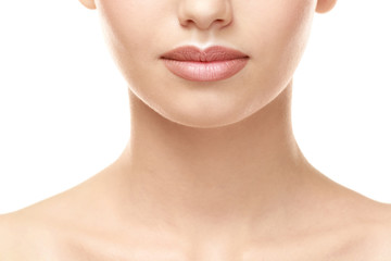 Woman with natural lips make up on white background, closeup