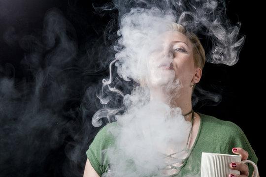 Young woman exhaling tobacco smoke