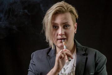 Female smoking vaporizer and thinking