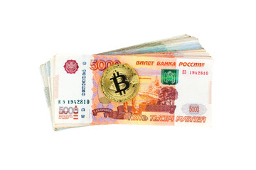 Bitcoin coin and stack of russian banknotes isolated on white background