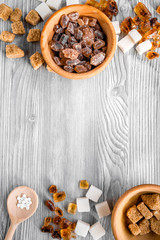 lumps and sanding sugar for sweets on gray kitchen table background top view mock up