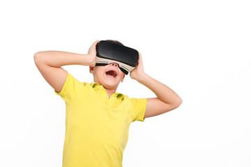 Amazed kid wearing VR glasses