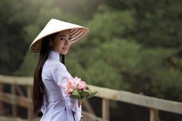 Medium long shot beautiful woman wearing Ao Dai Vietnam traditional dress