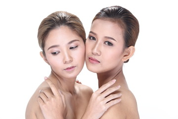 Two Asian women with beautiful fashion make up wrapped hair