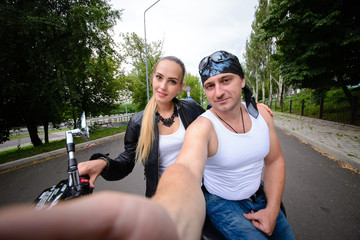 couple makes selfi on a motorcycle.