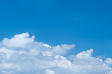 Blue sky and fluffy cloud