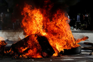 A barricade set on fire by opposition supporters is seen during a strike called to protest against Venezuelan President Nicolas Maduro's government in Caracas