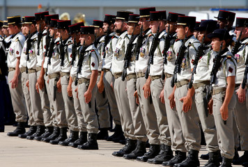 French soldiers attend a military ceremony at the military base in Istres