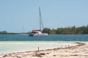 Yacht at the beach Playa Paradise of the island of Cayo Largo, Cuba. Copy space for text.