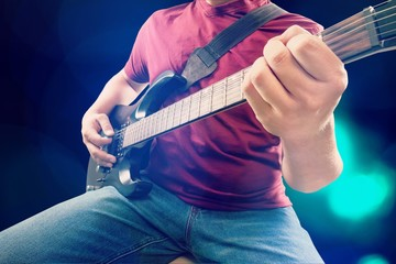 Man and guitar.