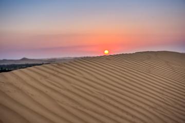 Sunset in the desert. sand dunes