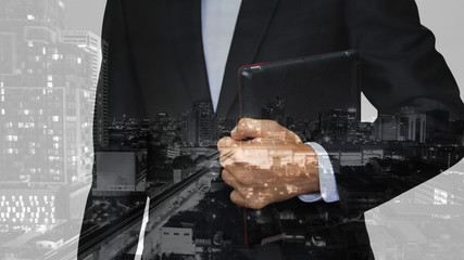 Business man with tablet and modern city