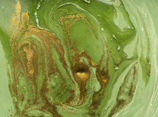 Marbled green and gold abstract background. Liquid marble pattern