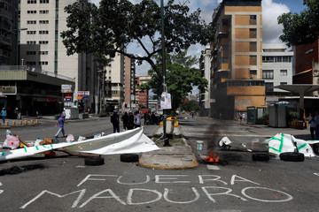 Opposition supporters participate in a strike called to protest against Venezuelan President Nicolas Maduro's government in Caracas