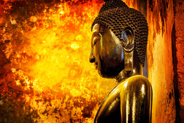 Buddha statue on colurful grunge wall background