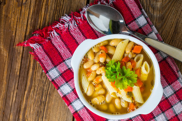 Bean soup with penne pasta.