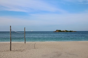 Beautiful tropical sea beach with  volleyball net in summer at Thailand.