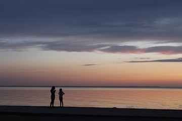 Girls at the sea in the evening