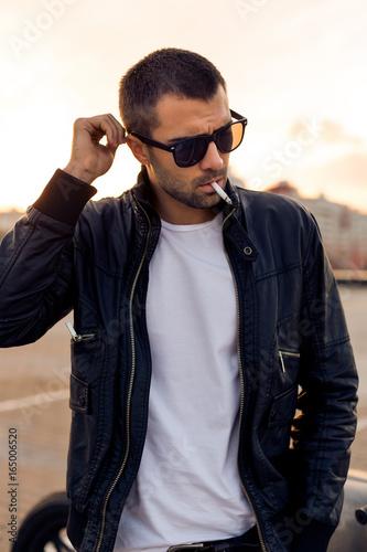 2173d9327dda Handsome rider guy with beard and mustache in black biker jacket ...