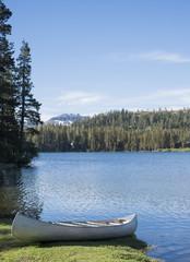 Canoe on the shore of a mountain lake
