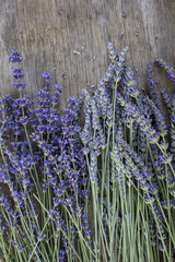Overhead shot of cut lavender on wooden surface