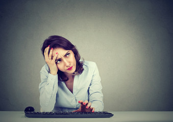 Desperate woman trying to log into her computer forgot password
