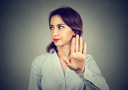 Angry woman giving talk to hand gesture