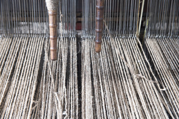 Yarn on spools in textile mill