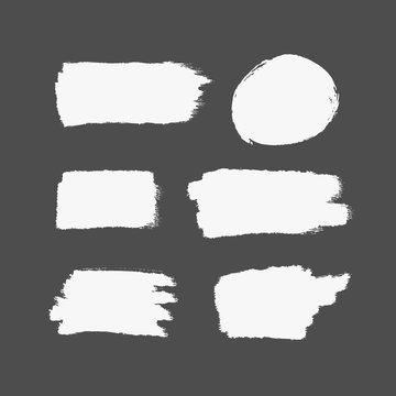 Texture of white brush strokes. Rectangular and round strokes. Set of isolated brushstrokes.