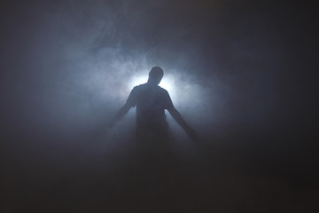 Silhouette of man in fog