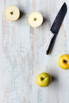 Yellow apples with knife
