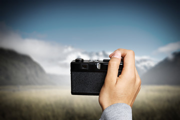 Man taking photo with vintage camera