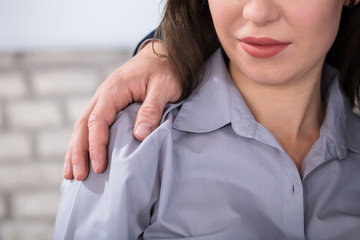 Man's Hands On Woman's Shoulders
