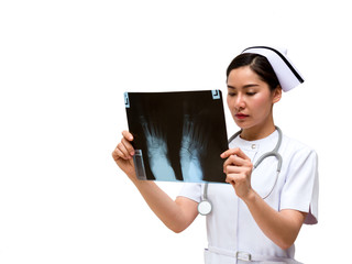 Young Asian nurse look at x-ray film