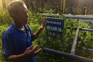 Farmer Vu Dinh Vinh shows place where he said that villagers found waste water released by Hong Kong's Pacific Crystal textiles factory in Hai Duong province, outside Hanoi