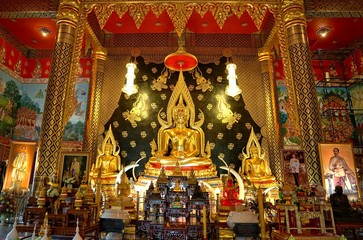 Golden buddha statue in main hall of  Wat Nimit Vipassana, temple at dan sai, Loei province, Thailand